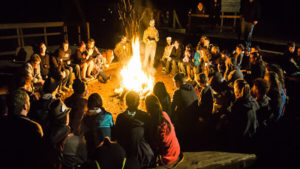 Business Retreat Around A Campfire